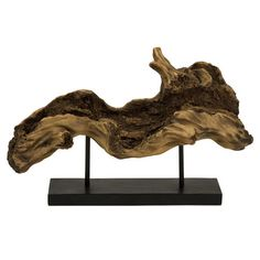 Bring natural appeal to your living room or home library with this driftwood-inspired sculpture, showcasing an organic silhouette and black metal stand.