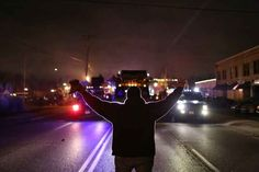 "Here Are The Most Powerful Photos From The Ferguson Protests- I particularly like the one of the officers with signs that read things like ""I am not Darren Wilson."""