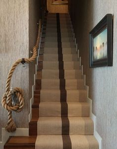 Rope can be used for all sorts of things, even staircase railings. A thick rope draped on the wall should provide safety for the users while also being an eye-catching accessory. It can help create a very interesting chateau-like look and it's also unusual and out of the ordinary.