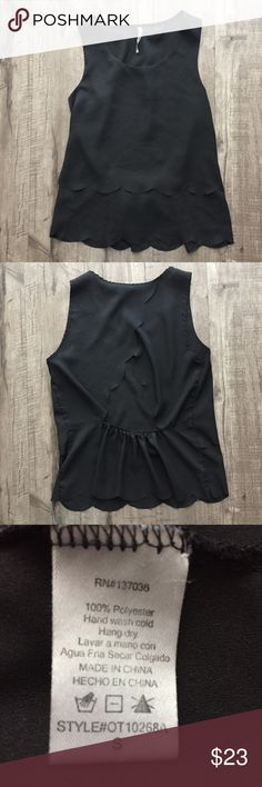 """Paper Crane Black Scalloped, Open Back Shell Tank Paper Crane Scalloped Hem, Open Back Shell Tank Color: Black Condition: New Without Tags (NWOT) Material: 100% Polyester Approximate Measurements (laying flat): Bust 16""""; Length (from shoulder) 22""""  Features a scalloped, layered hem detail and open back. Super cute staple piece, great with a pair of skinny jeans and a cardigan. Paper Crane Tops Tank Tops"""