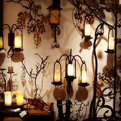 Display of some of our rustic lighting pieces along with iron trees. Such beautiful lighting. Woo Creations, Inc. Rustic Lighting, Candle Sconces, Virginia, Interior Decorating, Wall Lights, Trees, Iron, Candles, Display