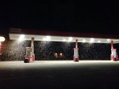 The picture above might look like a gas station in a blizzard, but those particular particles aren't snow. What you're seeing is a huge swarm of mayflies that erupted from the Mississippi River on Sunday night in Wisconsin.
