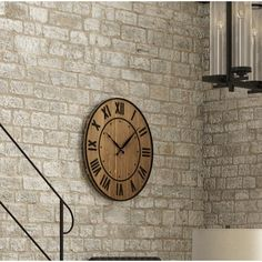 Versatile style abounds with this wood and metal wall clock, showcasing a wine barrel-inspired design. Its plank details pair perfectly with rustic decor while its rivet accents match with industrial options and factory-inspired furniture. Add it to the dining room to complement a cozy loft ensemble or use it to round out a bold boho look in the den. Its round silhouette adds traditional flair to both formal and casual aesthetics while its natural hues blend effortlessly into any color ... Stairway Gallery Wall, Traditional Wall Clocks, Wall Clock Online, Farmhouse Wall Clocks, Wooden Clock, Large Clock, Iron Wall, Wood And Metal, Rustic Decor