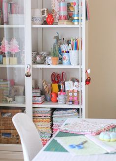cabinet storage, white table & chair