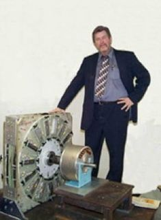 The Inventor of the Magnetic Generator taing picture next to his Invention
