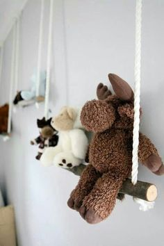 DIY branch swing for displaying the collection of stuffed toys.