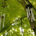 Baritone wind chimes add a lovely deep voice to the sounds of your garden. They are not any harder to make than any other wind chime but they do require more materials and a bit more time, especially if you want to tune them. Clay Pot Crafts, Shell Crafts, Backyard Covered Patios, Backyard Landscaping, Wind Chimes Sound, Cabin Crafts, Long Pipe, Tree Images, Wooden Plates