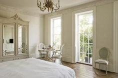 pretty room with wonderful windows & armoire