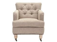 Evoking classic elegance, the Colin club chair in taupe linen upholstery is a timeless design that complements traditional and transitional furnishings. Inviting in the living room and cozy in the bedroom, Colin is crafted with a plush seat cushion and designer details from button tufting to brass nailhead trim and birch wood legs in a white wash finish.