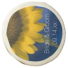 #Sunflower on Blue #Wedding Sugar #Cookie These delicious and pretty personalized Yellow Sunflower on Blue Wedding Sugar Cookies make a great engagement party, shower or wedding favor or add them to your dessert table for a tasty treat. Customize them with the names of the bride and groom and specific marriage ceremony date. These cute and custom floral wedding cookies feature a yellow sunflower blossom with a blue background. #sunflowerwedding #weddingfavors