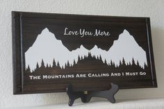 Gift -  Love you more  - wall plaque sign - The Mountains Are Calling and I Must Go.Dark stain with vinyl 22x11 gift sign home decor ski lodge personalized family mountain plaque custom mountain sign skiers and sking outdoor adventure wall plaque mountains are call valentines day gift gift for him her 69.95 USD #goriani