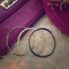 Three silver bangle Metal bangles in three different times of silver. Jewelry Bracelets