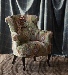 Game Birds Velvet Fabric A distinctive printed velvet featuring a variety of multi-coloured native British game birds set amongst branches and foliage on a stone-coloured ground.