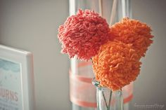 Yarn pom poms in this aqua and orange baby sprinkle!