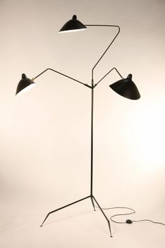 """Serge Mouille, Standing lamp """"This is the most versatile lamp of the Mouille collection. Each 'chapeau' shade can be oriented differently. Sculptural in form with 3 rotating arms, it stands majestically on a tripod base ending with tapered legs. Elegant Home Decor, Elegant Homes, Luminaire Design, Lamp Design, Modern Lighting, Lighting Design, Lighting Ideas, Luminaire Original, Serge Mouille"""