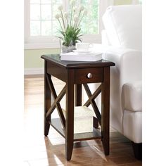 Featuring a shelf and drawer for storage, this rectangular table features a pretty cross design on the sides. This accent table will add a touch of contemporary sophistication and classic beauty to any living or dining space.
