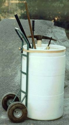 handicar and garbage can/drum = garden cart. Genius! Round Up: 10 DIY Garden Tool Totes and Benches » Curbly | DIY Design Community