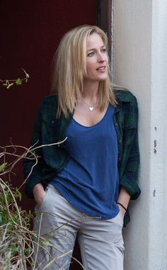 Gillian Anderson street casual in a sheer loose blue scoop necked blouse over a thing bra / lingerie, star of The X-Files, Hannibal, and American Gods, a modern classic beauty. Dana Scully, Gillian Anderson David Duchovny, Gorgeous Women, Beautiful People, Stella Gibson, X Files, David And Gillian, Manequin, Elegant Woman