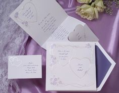 Interlocking hearts and purple roses are featured on this lovely bright white invitation. Heart Wedding Invitations by Wedding Invitations -The Office Gal