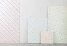 Scales Tiles, Designed by Alberto Sánchez of MUT Design for HARMONY by Peronda.  These uneven tiles appear to almost vibrate with the help of the electric colors added to two of the sides.