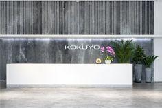 A natural stone backdrop & festive greenery greets guests at the KOKUYO Flagship Showroom - Shanghai - Office Snapshots