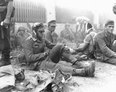 Wounded German soldiers taken as POWs by American troops during Operation Dragoon wait to be treated by medics at a collection point. The operation was second invasion of France, the first being the D-Day landings in Normandy. Operation Dragoon was. Operation Dragoon, D Day Landings, Man Of War, Historical Images, German Army, American Soldiers, Medical, Military History, Ww2 History
