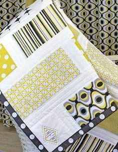 Citron Gray Monogrammed Nursery Quilt | FaveQuilts.com