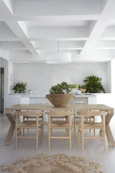 The dining room features a dining table by Australian brandZuster and Hans Wegner chairs.  Courtesy of Sharrin Rees.