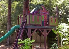 huge Tree house with slide, rock wall, swing, etc