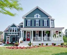 Love the color and the porch!