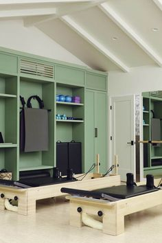 Navy Interior Design: Los Angeles Pilates Studio, Bleached Cork Floor, Vaulted Ceiling, Bronze Hardware