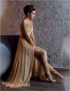 Beige Churidar. No idea about the designer.But this sure is gorgeous....