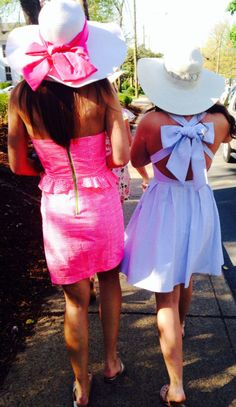 I love the wide-brimmed hats and the bow on the back of the dress. It's so elegant