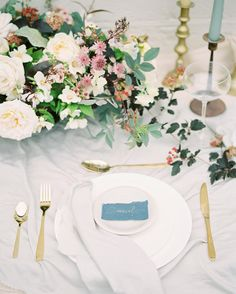 Table setting for an engagement shoot featured on @stylemepretty today captured so beautifully by @imogenxiana  Table florals by @thegardengateflowerco with flowers grown by @gandgorgeousflowers  Dress @cherrywilliamslondon  hair & Mua @hairbyhannah_uk Table runner and napkins by @lancasterandcornish stationary by @plumecalligraphy #britishflowers #gardengateclasses