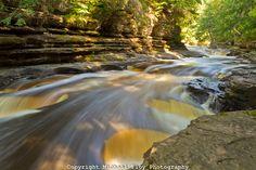 It looks like a river of caramel!!!  Presque Isle River, Cascades, Porcupine Mountains