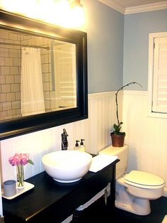 love this bathroom...small, clean, and simple1 love the color contrast too.