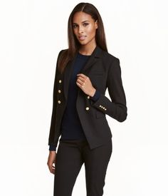 Black. Double-breasted, fitted jacket in woven stretch fabric. Chest pocket, pockets with flap, and decorative buttons at front and at cuffs. Lined.