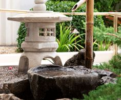 Tsukubai Water Fountains, Japanese Garden Design Ideas - There are different types of small water fountains and stone bowl designs for creating a Japanese garden: Chōzubachi 手水鉢  Hand Water Basin, Tsukubai  蹲踞 (つくばい)  Stooping Basin, Zenigata Tsukubai  銭型蹲踞 (ぜにがたつくばい)Coin Shaped Basin . . .