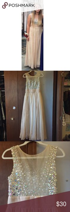Prom Dress This gorgeous prom dress is light pink and has sequins on the top! It is gently used, has 2 little spots (see image) but nothing noticeable! Comes from a smoke-free, pet-free home. Dresses Prom