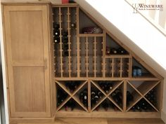 Compact bespoke under stairs wine racking with additional cupboard storage in Hampshire, enquire about your own custom wine room today!
