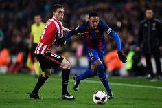 Neymar Jr. of FC Barcelona competes for the ball with Javier Eraso of Athletic Club during the Copa del Rey round of 16 second leg match between FC Barcelona and Athletic Club at Camp Nou on January 11, 2017 in Barcelona, Catalonia.