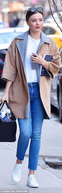 Twice as nice: Miranda Kerr showed off how to do polished casual perfectly as she stepped out in two looks in New York on Thursday