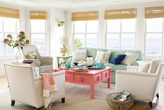 A pop of coral from House of Turquoise. We love how the textures of each of the pieces of furniture are different!