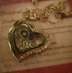 Police Wife Love Locket   - has 5 charms, blue and white heart, a heart that says Husband, a police shield and a wedding ring  - charms can be changed upon request for an additional $2 charge. To customize it please email me at: seagoddessjewelry@gmail.com  - If you pay for this item without an email sent you will receive locket as shown.     This was orginally a custom order and that is why the picture isn't so clear but it is a beautiful locket and pictures just do not do it justice…