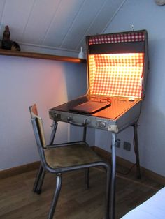Vintage suitcase repurposed as a lighting desk (adjustable height) Inside: red gingham oilcloth, wood and inkwell.