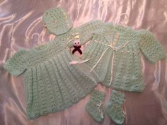 Mint green lacy layette in DK wool