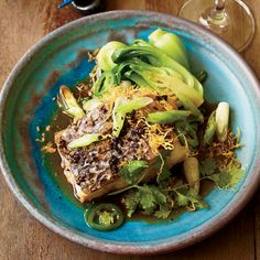 Steamed fish may sound plain, but this version is packed with flavor: It's cooked in a ginger-and-sesame soy sauce and topped with frizzled jalape&#24...