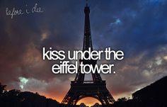 Kiss under the Eiffel Tower.