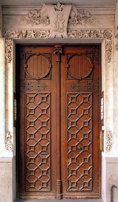 Carved wood door on a stone building in Barcelona