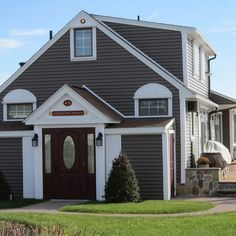 vinyl siding with brown roof | Monogram Sable Brown vinyl siding, with decorative pvc trim, sunbursts ...